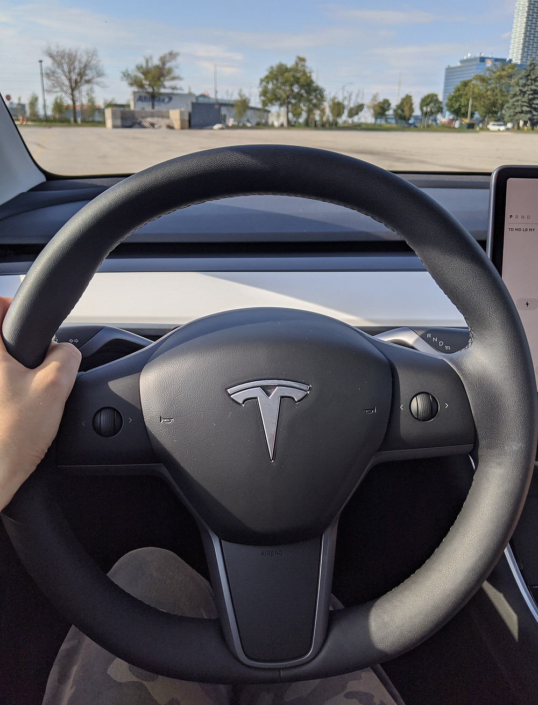 Tesla Model Y Interior Behind Steering Wheel