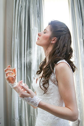 bride spraying perfume getting ready elegant photographed by Zandri du Preez Photography Wedding Photographer Cape Town