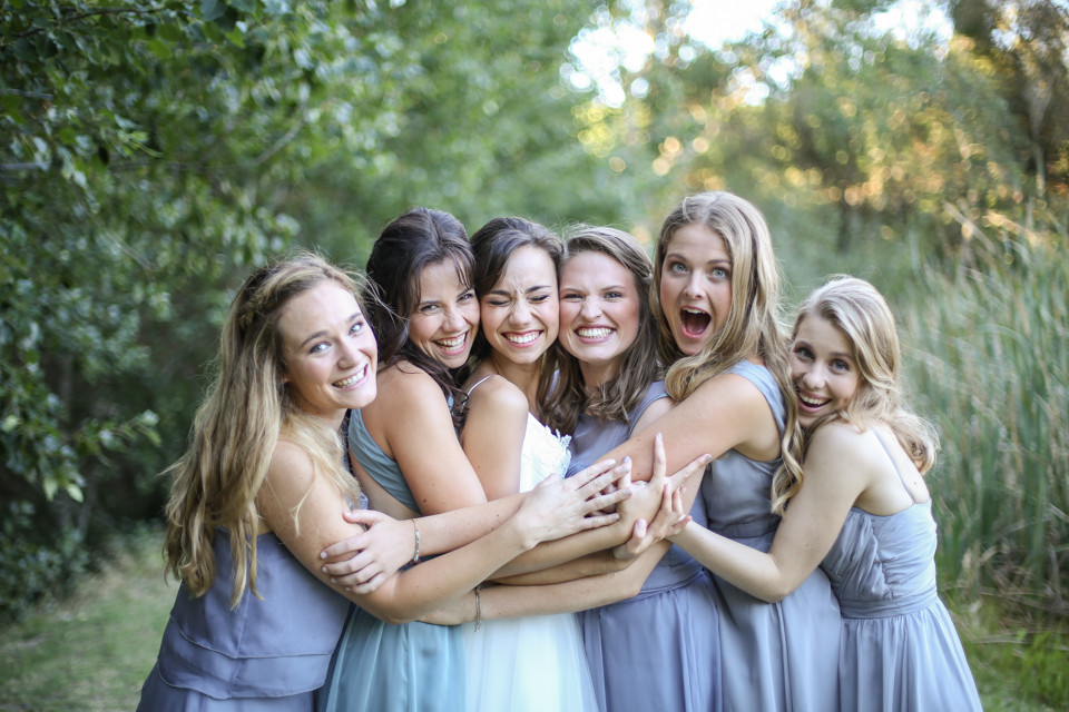 bride and bridesmaids laughing cape town wedding