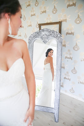 bride getting ready looking in mirror gorgeous photographed by Zandri du Preez Photography Wedding Photographers Cape Town