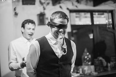 Groom with garter in mouth funny wedding photo photographed by Zandri du Preez Photography Wedding Photographer Cape Town