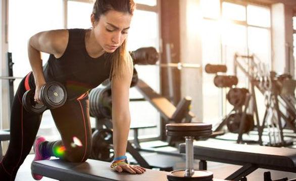 fitness-girl-lifting-dumbbell