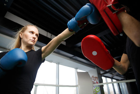 woman improving her fitness with one-on-one boxercise session