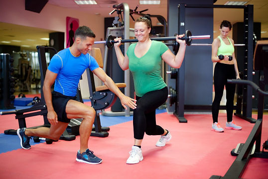 woman learning to lunge with personal trainer