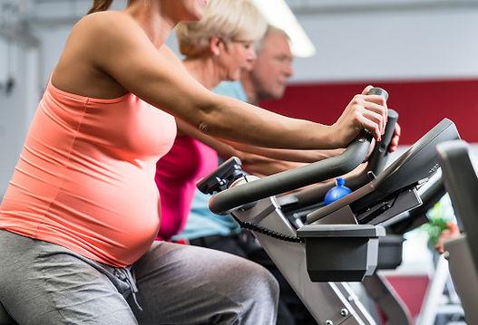 safe prenatal exercise on a bike in gym