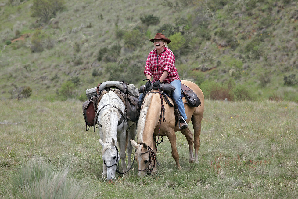 female rider with horse in the outback.j