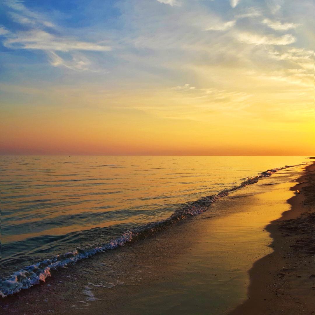 Закат на пляже в Неа Плайя