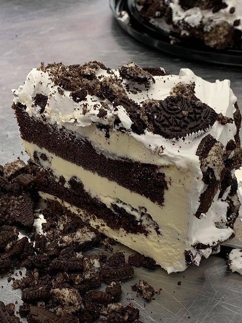 Ice cream cake slice, chocolate cake, frosting, Oreos