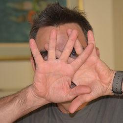 John Crane Hands to the Face