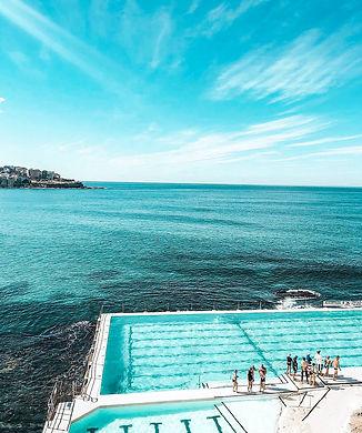 people-standing-beside-swimming-pool-226