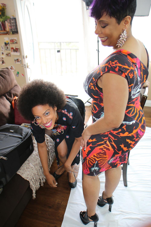 Shelisha's sister Jasmine assisting her on the shoot, bringing good energy.