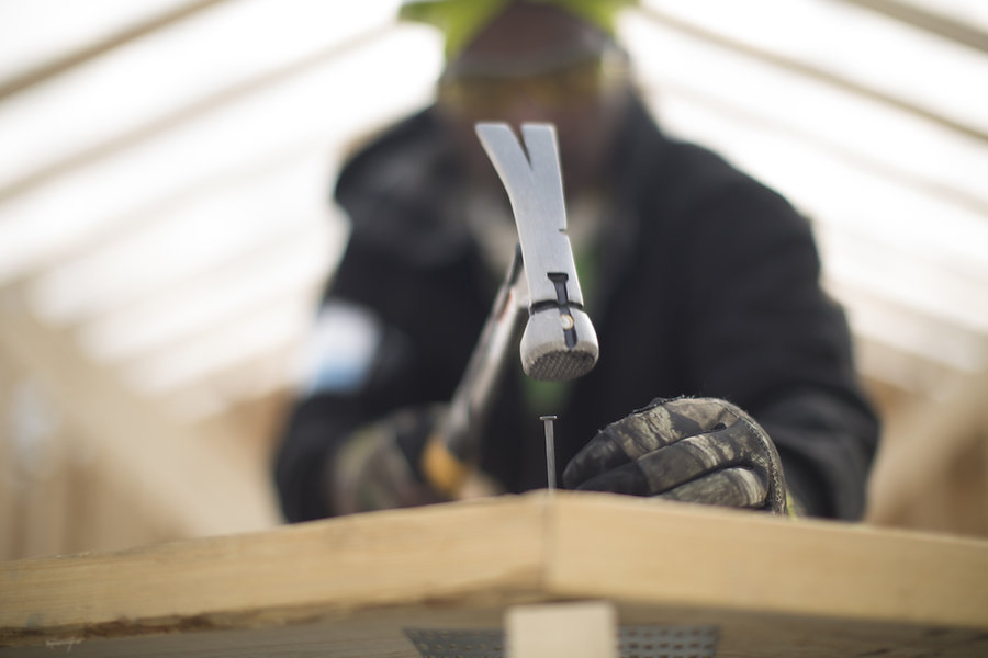 BLURRED PERSON-in focus hammer.jpg