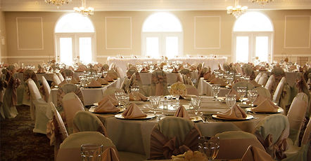 interior view of convention hall set upfor banquet tabes and  seating