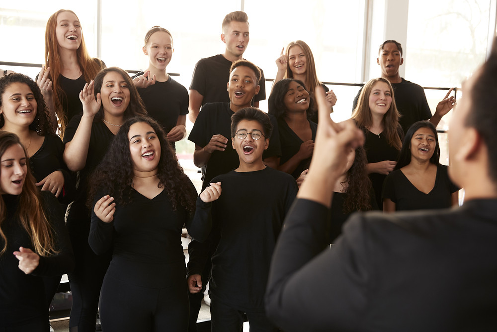 Young people singing in a choir.