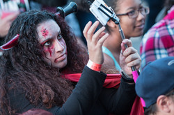 Bloody Woman Takes A Selfie At Georgia Zombie Festival