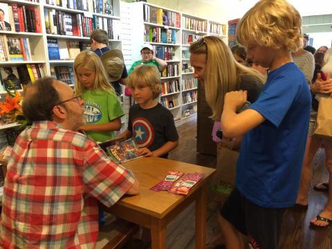 Author Dan Gutman mingles with guests