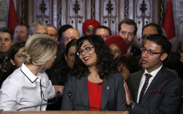 Member of Parliament Iqra Khalid is congratulated by colleagues as she makes an announcement about an anti-Islamophobia motion on Parliament Hill in Ottawa on Wednesday, February 15, 2017.