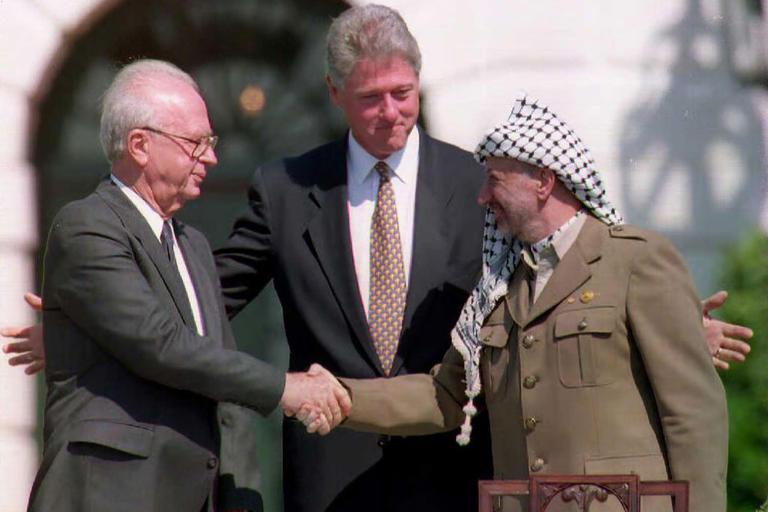 Israeli Prime Minister Yitzhak Rabin, President Bill Clinton and PLO Chair Yasser Afafat