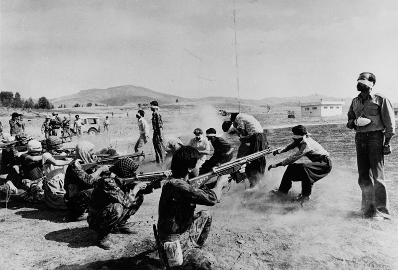 Jahangir Razmi's Pulitzer Prize-winning photograph of the execution of Kurdish men and others by the Iranian Islamic regime in 1979.