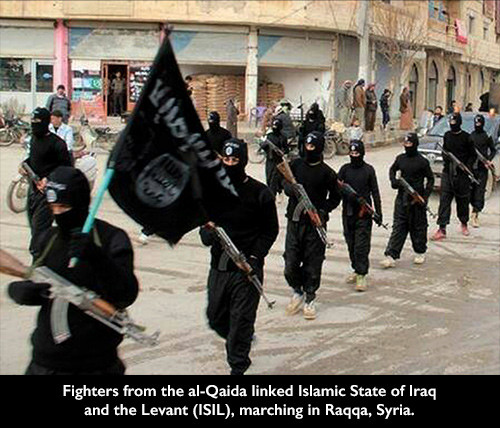 Fighters from the al-Qaida linked Islamic State of Iraq and the Levant (ISIL), marching in Raqqa, Syria.