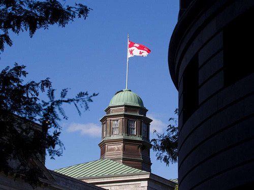 The McGill University flag flies from the top of its Arts Building in Montreal.