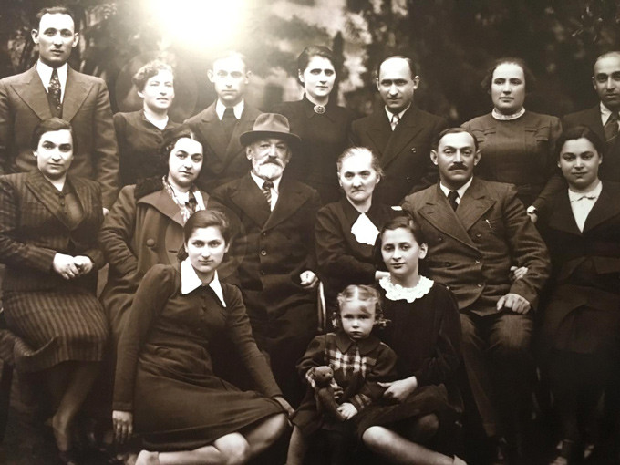 Photo of Fania's family; Fania is seated bottom left, before the War