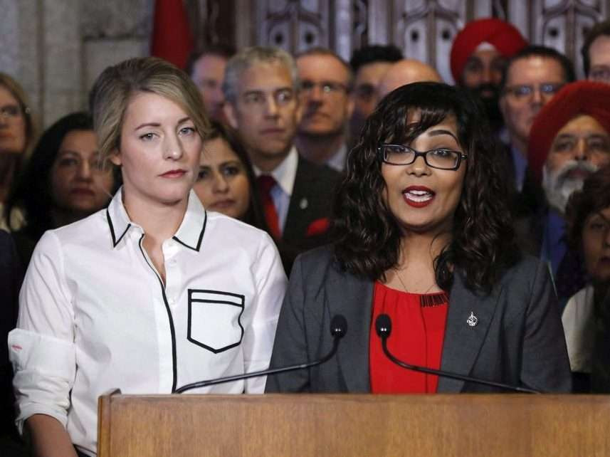 Liberal MP Iqra Khalid makes an announcement about an anti-Islamophobia motion on Parliament Hill while Minister of Canadian Heritage Melanie Joly looks on in Ottawa on Wednesday, February 15, 2017.