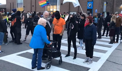 lady with walker blocked by antifa