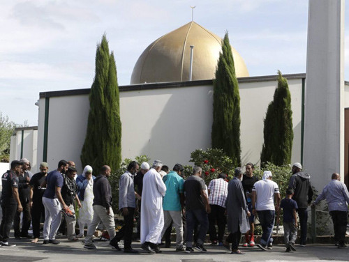 In this March 23, 2019 file photo, worshippers prepare to enter the Al Noor mosque a week after a mass shooting in Christchurch, New Zealand.