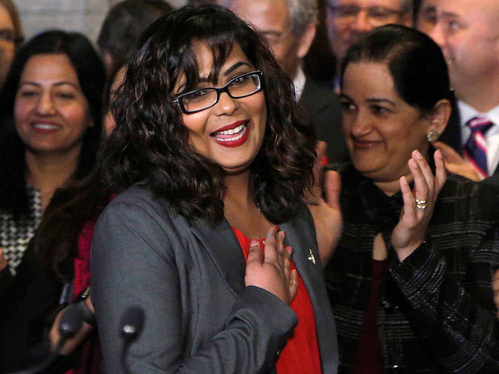 Liberal MP Iqra Khalid is welcomed by her colleagues as she arrives to make an announcement about an anti-Islamophobia motion on Parliament Hill in Ottawa on Wednesday, Feb. 15, 2017.