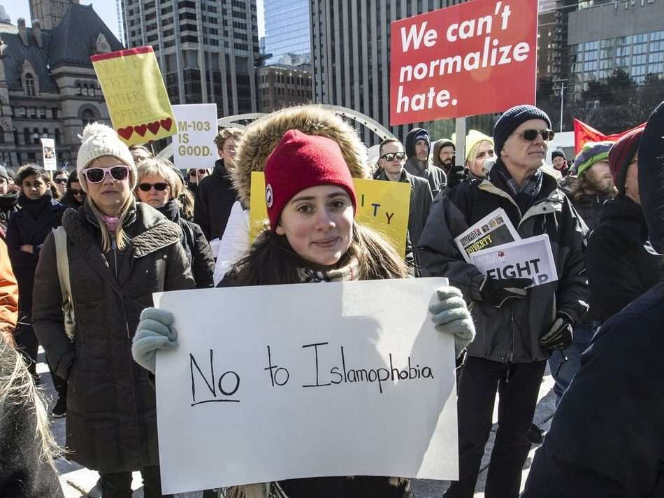 Demonstrators protest against Islamophobia and for free speech clash at City Hall in Toronto, Ont. on Saturday March 4, 2017.