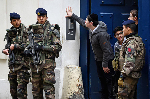 Pictured: French soldiers guard a Jewish school in Paris.