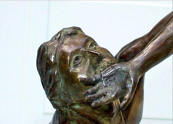 The Martyrdom of Stephen (face) bronze by Scott Johnson
