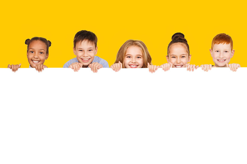 Happy children with empty board for your text isolated over yellow background, copy space.