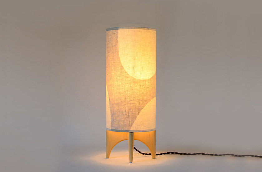 Illuminated beige LUMA table lamp, front view
