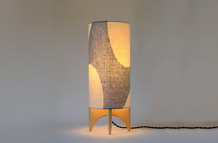 Illuminated grey and off white handcrafted LUMA lamp