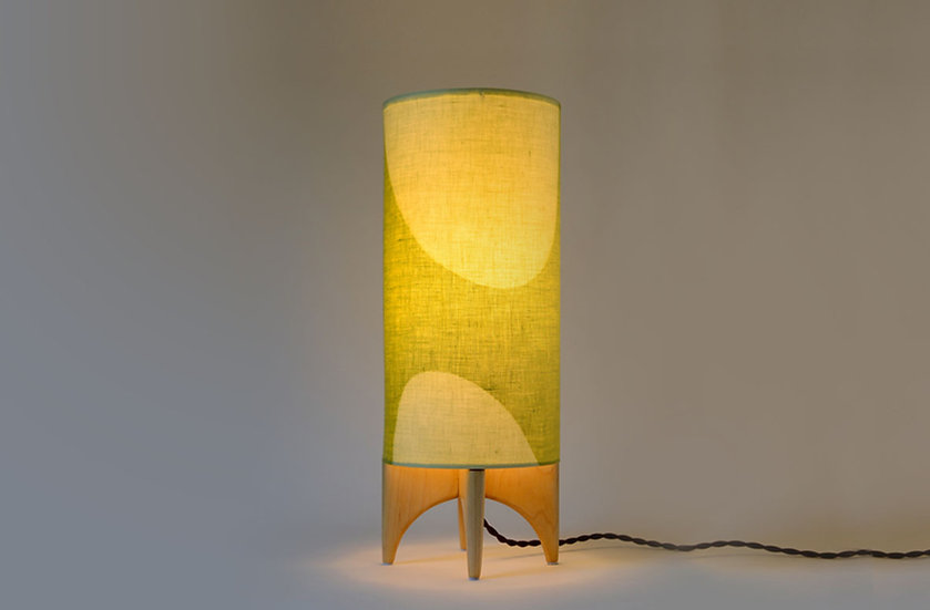 Illuminated front view green and white LUMA table lamp