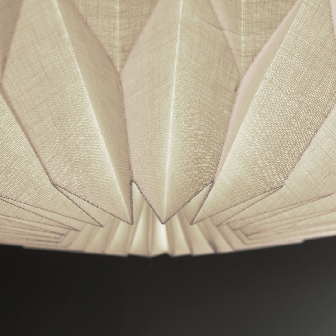 Close up view of a hanging origami pendant lamp