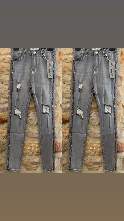 Pale grey torn jeans with silver side stripe