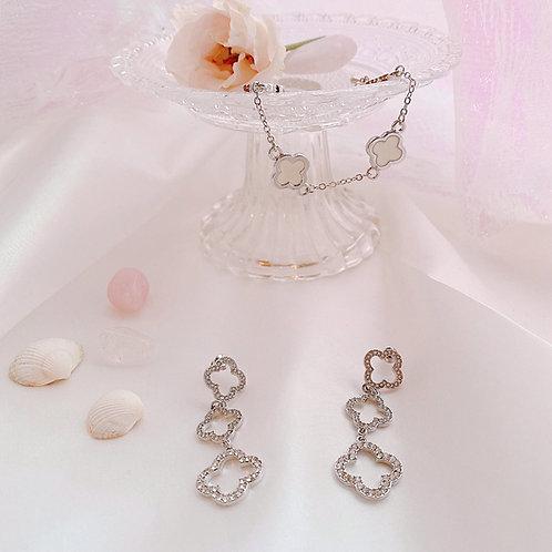 Long drop flower motif earrings