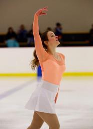 anna skating orange.jpg