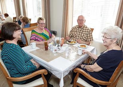 seniors and volunteers eating