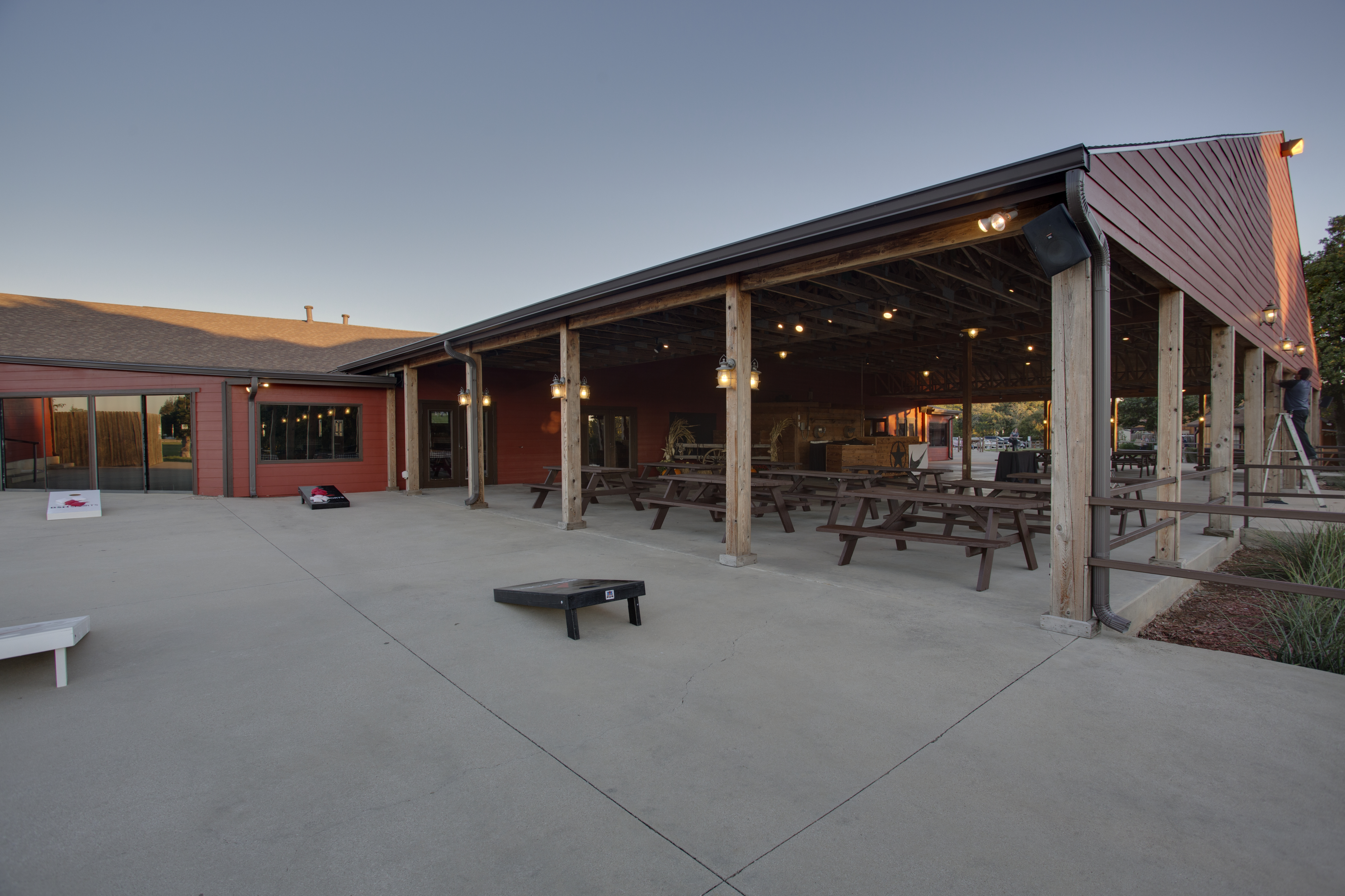 circle r ranch west patio with corn hole