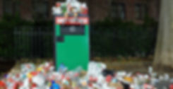 rubbish bin full of disposable cups crop