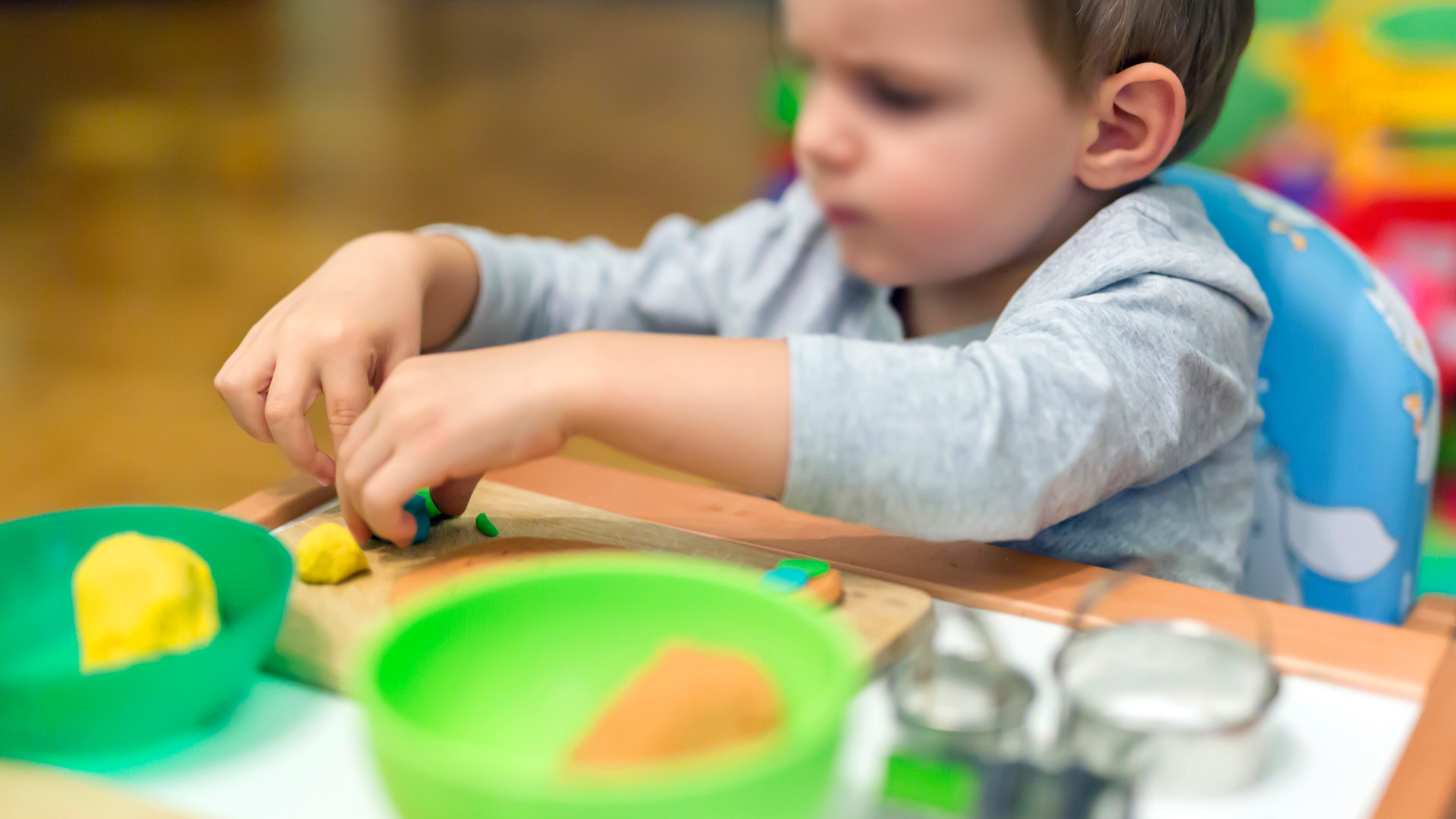 little-boy-working-with-clay-WDQE4HW.jpg