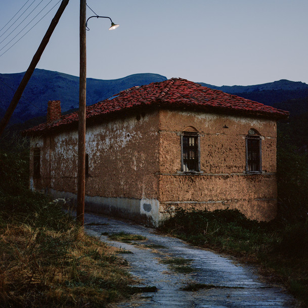 """How does one define a 'family space'?   I would like to conclude our Family Spaces photo-conversation between Kristina and myself with this image, titled The Road Home.   This photograph was captured in my family's village in northern Greece and is a part of my ongoing work 'Where the Wildflowers Grow'. The project aims to question the notions of home, family and community as well as land, which were all affected by the Greek Civil War.  The discussion on this topic is over, but only for the two of us, as we will be introducing other photographers and their works on the topic of Family Spaces.   - Michaela"