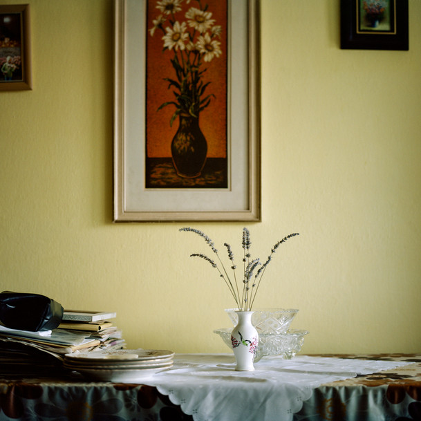 """This image was captured in my grandmother's flat in Bratislava, Slovakia, where she's been living for a few decades now. It's the first photograph that came into my head, when I started thinking of the topic 'Family Spaces'.   As a child, I used to hang out in her flat all the time, especially looking through old archival photographs of our family trips - my grandmother has probably the biggest collection of all our family photographs. But also, this is the very first photo that I'm sharing from my ongoing project 'Where the Wildflowers Grow' that explores family roots, home as well as migration and conflict.  Through this project, my intention was to find out more about the reasons behind my grandmother's forced migration from Greece to former Czechoslovakia and the way it shaped her identity and our family history. The work also involves some images from my grandmother's personal archive.""  - Michaela"