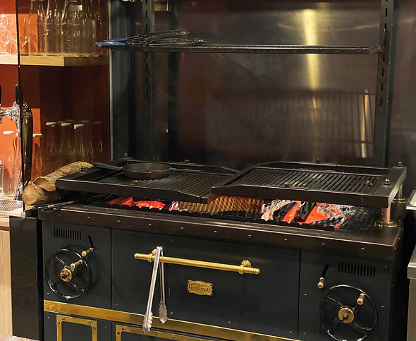 Fresh seasonal produce consisting of meats, seafood, fish and seasonal vegetables cooked over hot coals and open flame on the customised cast iron charcoal grill