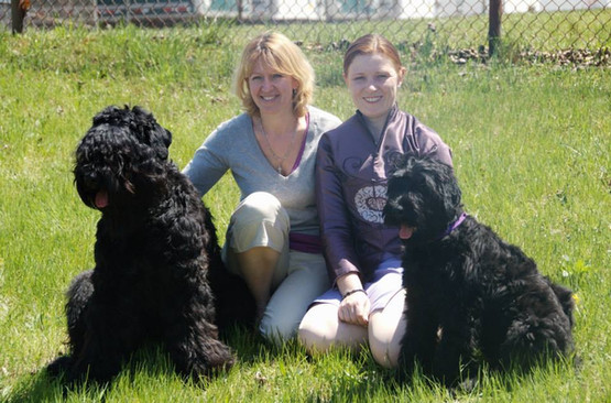 Black Russian Terriers with Owners and Handlers