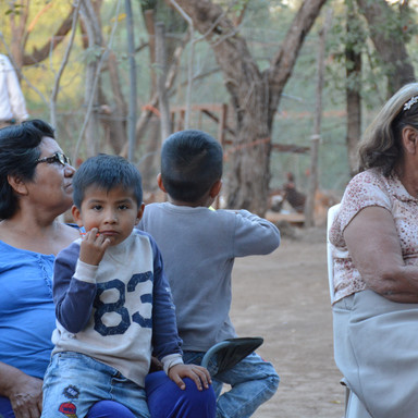 A child waits to be seen by a pediatrician as part of our rural outreach community health clinic